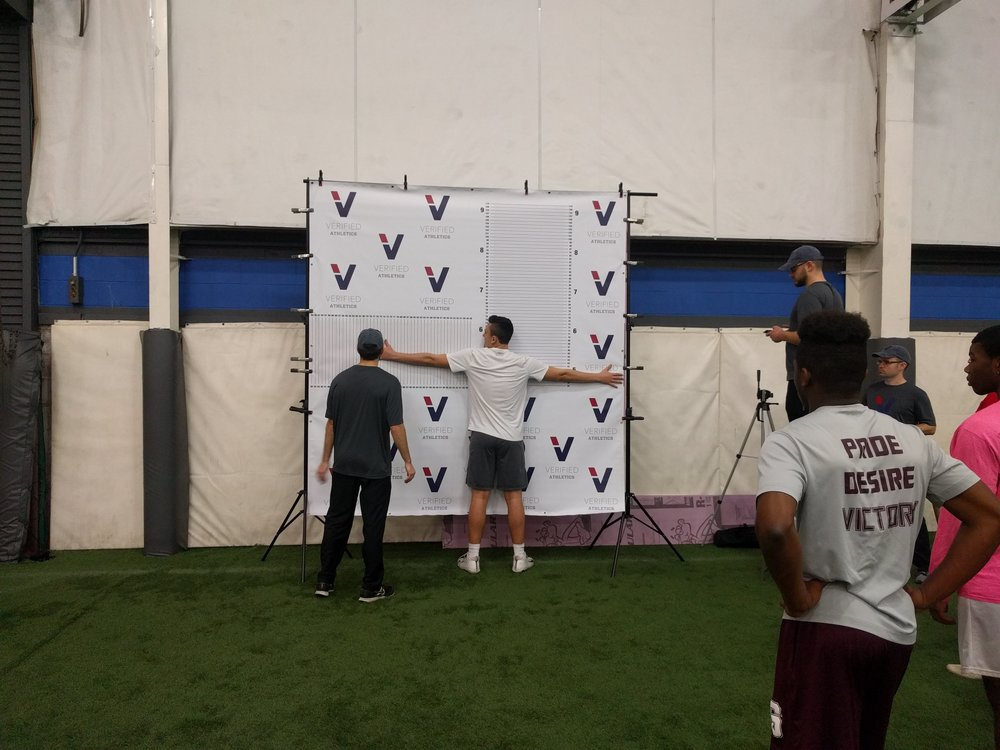 Our team measuring the athlete's wingspan