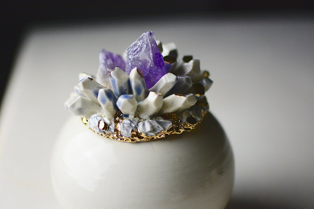 amethyst clusters inside lavender and white porcelain crystals.
