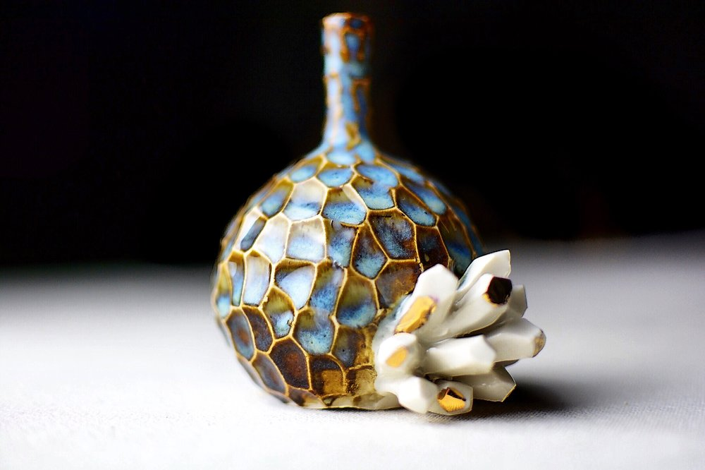 Mini rutile blue vase with a white crystal cluster.
