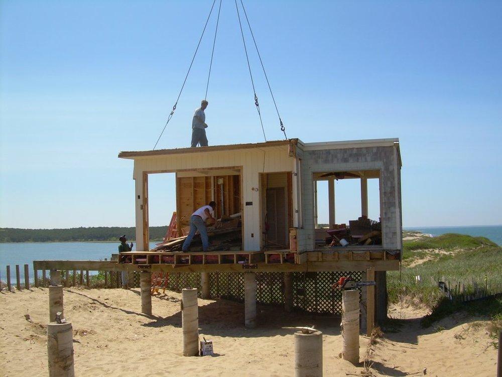 Safe Harbor image, showing partial demolition on site.
