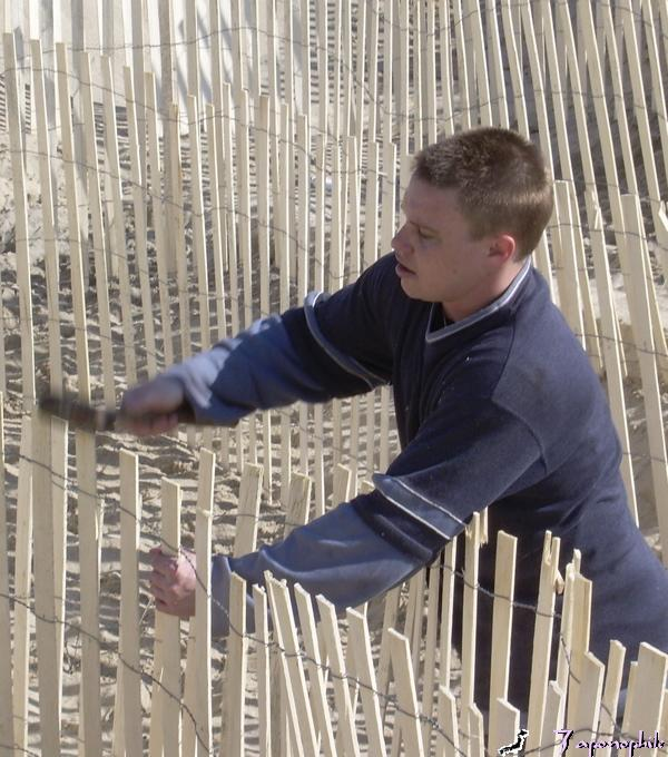 Sand fencing prevents wind generated sand erosion by controlling wind speed. Fencing placement should be three to six feet apart for best performance. Fencing also generates sand deposition because when wind is slowed down, it drops the sand it is carrying. Fencing slats can be individually driven into the sand instead of using additional stakes.