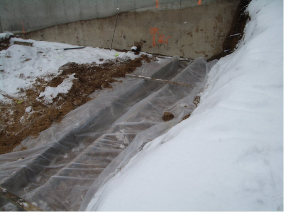 Plastic will prevent caustic water from entering ground water during footing pour