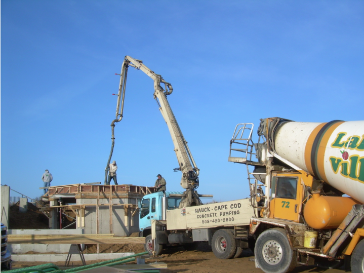 Concrete truck and pump truck on site