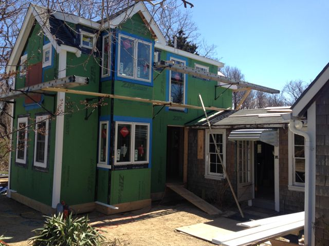 Sheathing and fenestration completed. Vapor  barrier installed.