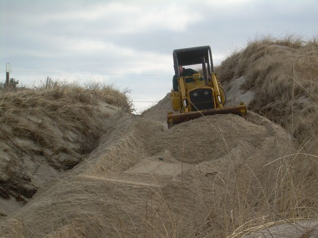 Sand being Bulldozed by Town