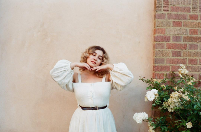 Emily wearing the Lucy in Italy dress, available via Hannah Metz.