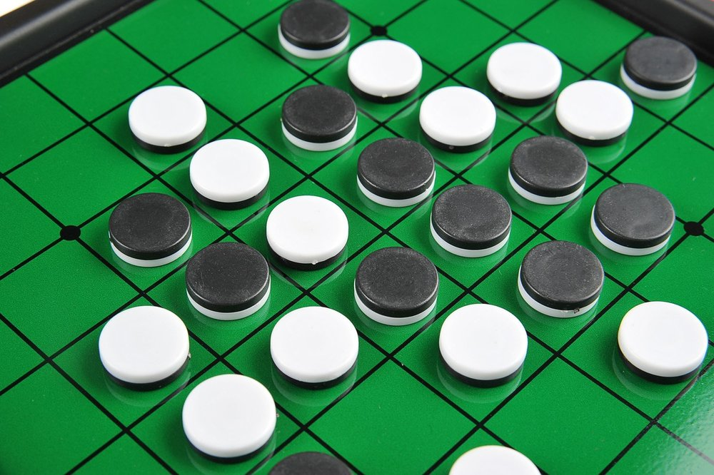 (Othello is the trading name of a much older board game called Reversi. It can only be played as a 2 player game. Players battle to finish the game with more of their own pieces on the board than their opponent. The game is finished when there are no spaces left on the board or when there are no more possible legal moves for either competitor).