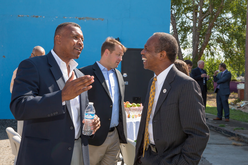 Virginia Secretary of Agriculture Basil Gooden speaks with Hampton Mayor Donnie Tuck.