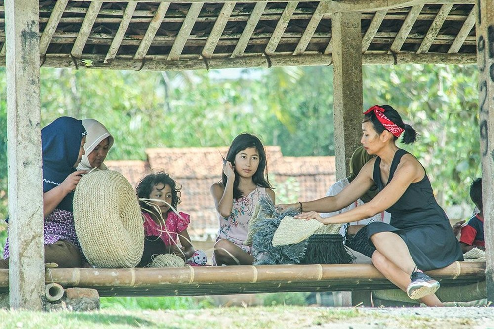 My daughter and I in Kulon Progo with our artisans and their children