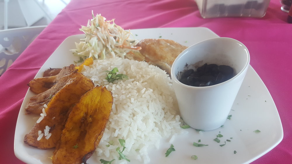Traditional Costa Rican Meal. Rice, beans, plantain, coleslaw and grilled chicken.