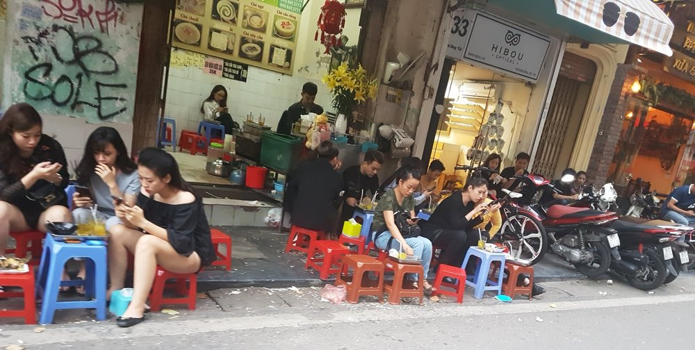 Typical view of a Hanoi Street. Little chairs, little tables, lots of food with big flavours.