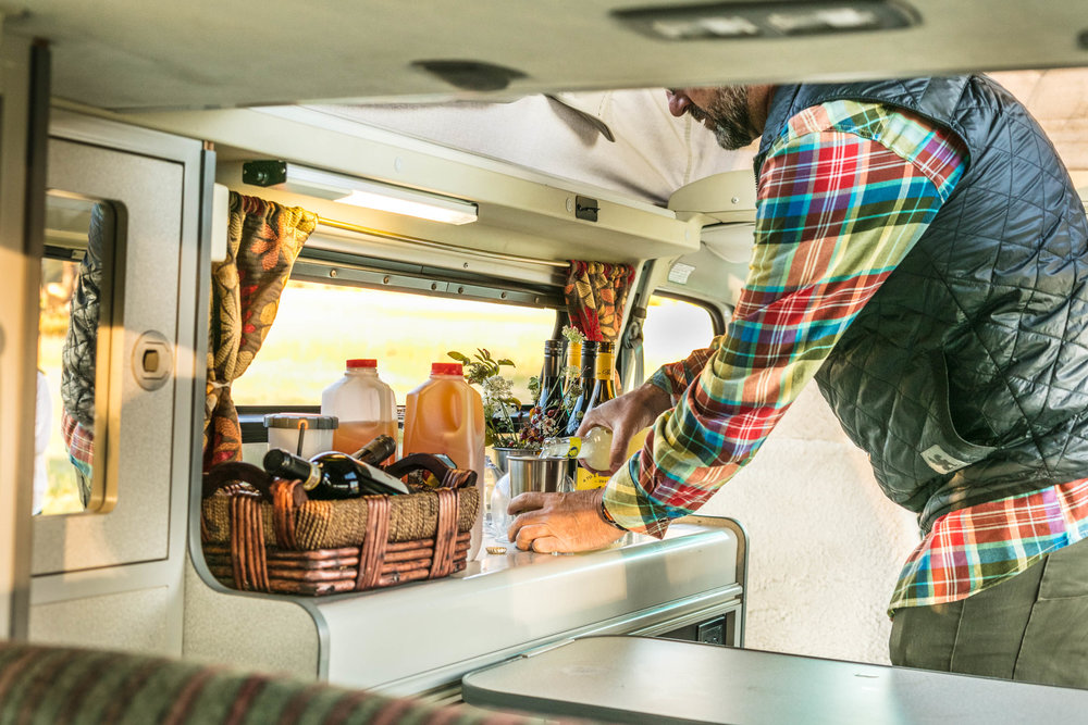 STEP 3: ENCOURAGE SELF-SERVE. All GoCamp vans have plenty of cups and wine glasses so you don't need to worry about having enough. We swiveled the two front seats to face the rear bench seat and created a fun party space inside the van.