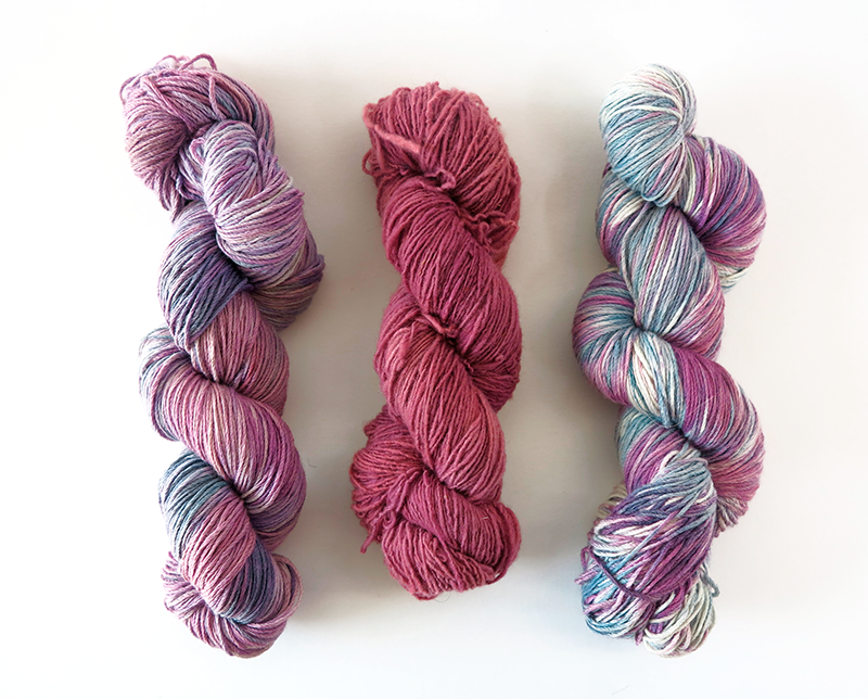 100% hand-dyed blend of merino and silk (left / right end) & 100% fine merino(center)