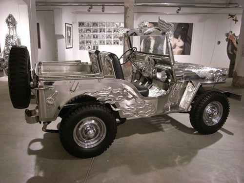 Alfredo + Isabel Aquilizan, In God We Trust (2009-2010), stainless steel, WWII Willys Jeep parts, 350 x 150 x 180cm. Installation view: Verso Artecontemporaranea, Turin