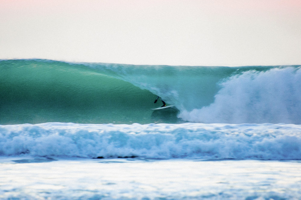 Pictured is big chief Chester on an absolute winter bomb at low tide splash! Proof that you don't need to go far for world class waves and great times!  photo - http://www.robbiedark.com
