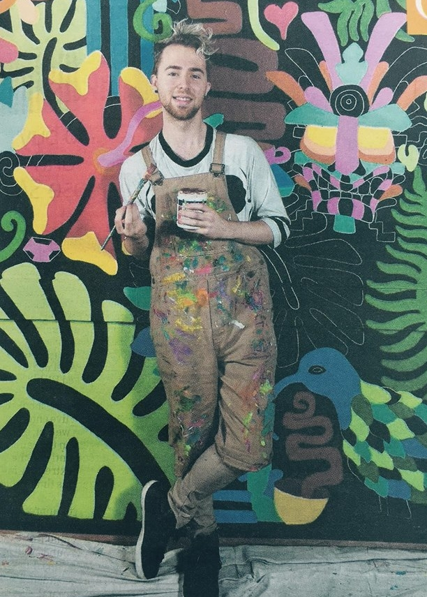 Artist AZZURRO at Fair Espresso in Adelaide's central markets in front of his mural. Picture: Campbell Brook for interview with City Messenger, 2016