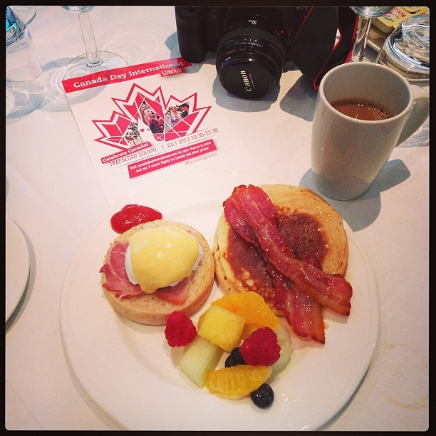 My delicious @canadadaylondon breakfast @thistlehotels with @KatchLondon. Pancakes with maple syrup, fresh fruit salad and eggs benedicte. (I'm here representing you Kayla!) #canadadaylondon