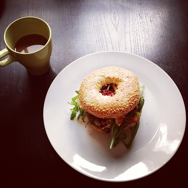 Saturday breakfast with @jmgcreative. Grilled sausage, bacon, halloumi, rocket and cranberry sesame bagel. #food