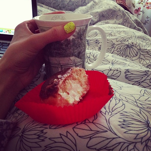 Sunday morning breakfast. Half a #KrispyKreme donut and a coffee in bed shared with @jmgcreative. #happy