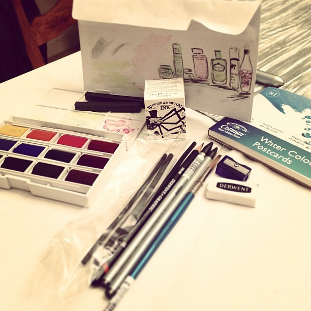 Inspired by @garancedore & @GoddessGuide's Gisele Scanlon. I've treated myself to a little set of @winsorandnewton watercolours today along with some indian ink, graphite sticks, charcoal and a book of blank watercolour postcards. Hopefully this means I'm in for a creative 2013. It's been far too long since I painted something. I've sketched a few little illustrations of some of the beauty gifts I got from my family this Christmas. (I'm a bit rusty…) #newyearsresolution #art #creative #inspire #painting #watercolours #artist #illustration