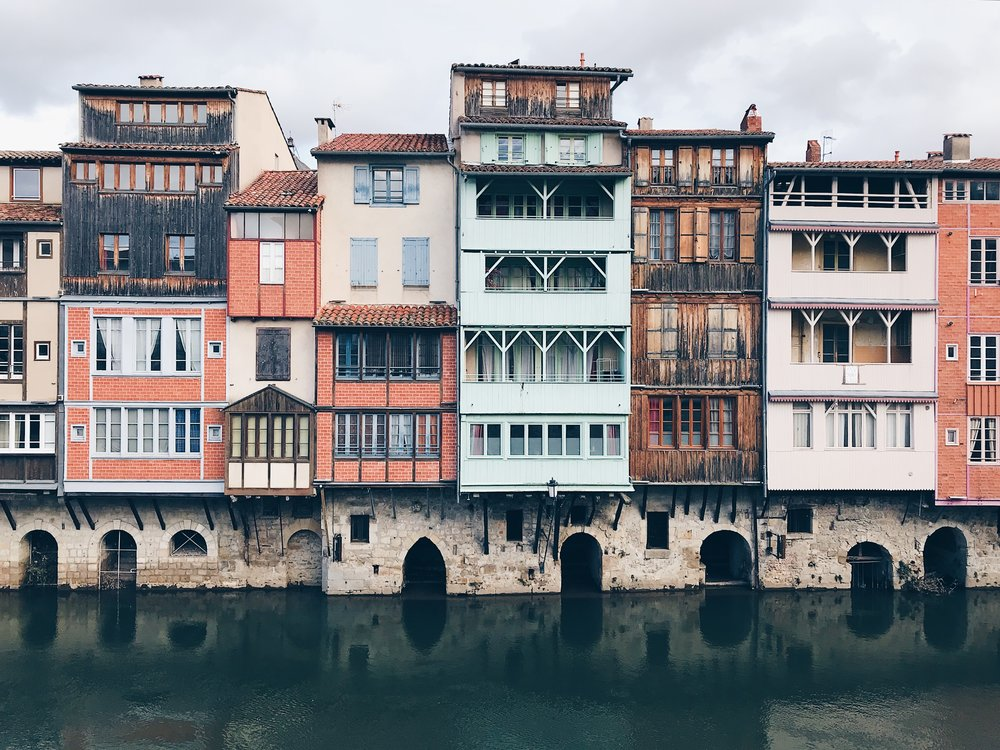 Pretty pastel buildings on the waterfront in Castres
