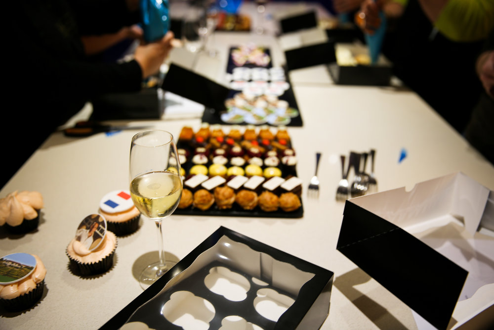 Petit fours and a glass of Paul Mas sparkling wine add a little fizz to our cupcake frosting!