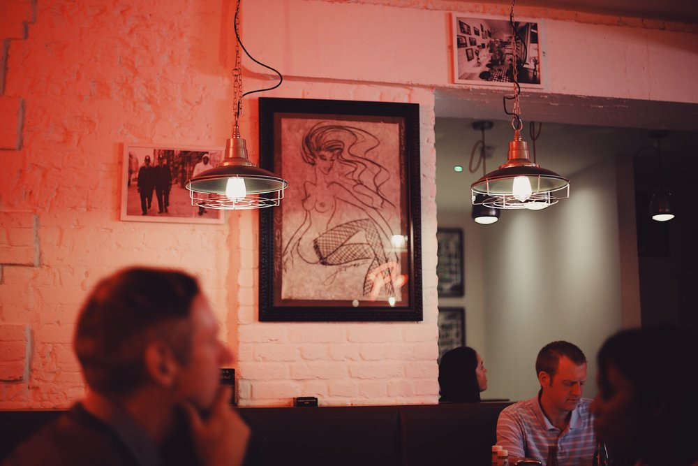 Saucy tongue-in-cheek posters, nude art work and red light district neon signs make Piebury Corner the perfect cheeky date night spot
