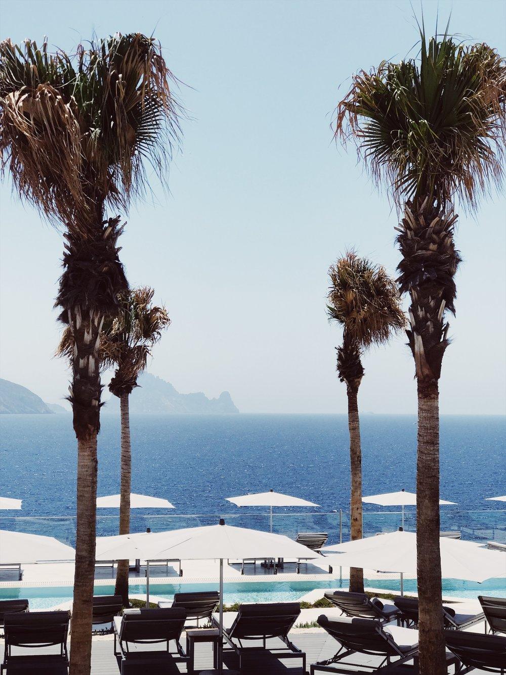 Enjoying stunning sea views from 7 Pines Resort Ibiza sun terrace