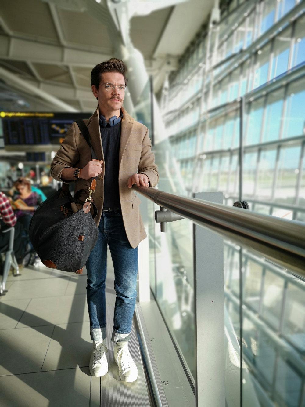 Milan-ready, Robin James at London Heathrow Airport.