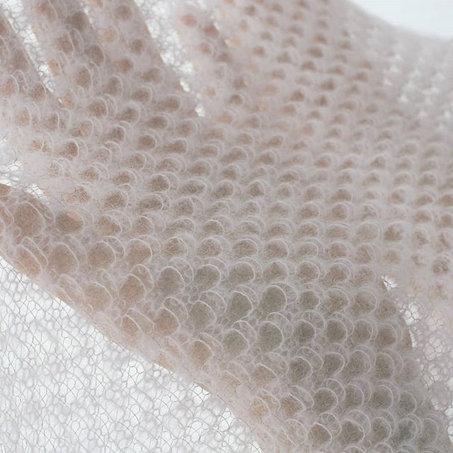 Textile soft as snow.  #knit #knittingtextures #alpacayarn #goldlurex #transparent #weddingscarf