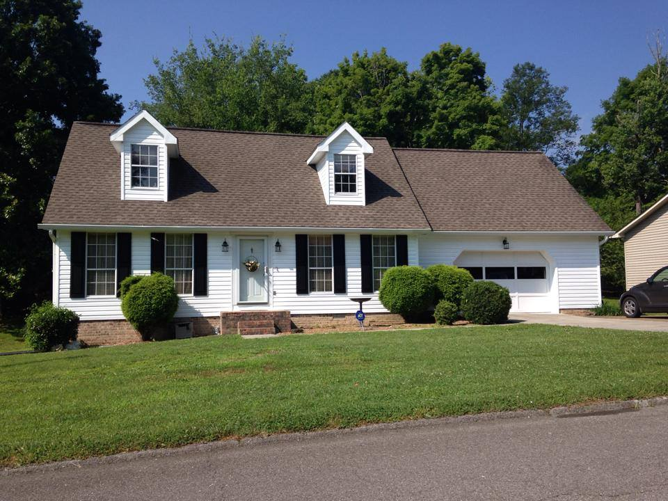 white vinyl siding and driftwood shingle roof