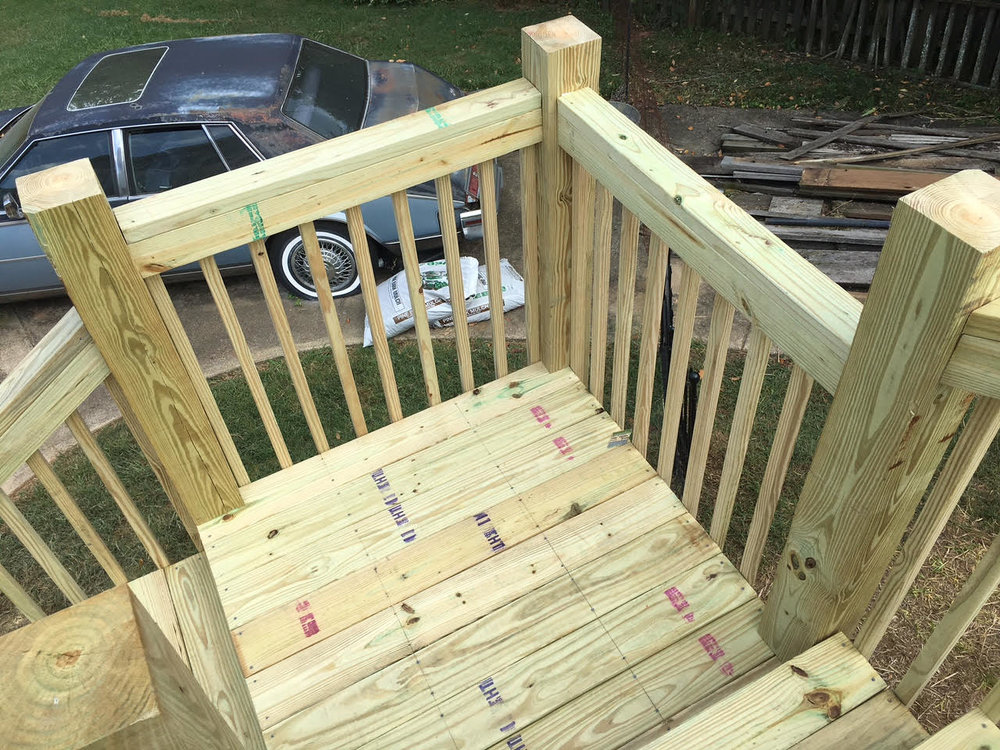 wood deck railing on stair landing