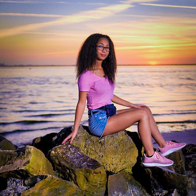 """"""" I'll have a Lotus on the rocks please """"  Post 4/365  #beauty#nature #sunset #rocks #modeling #adidas #tubular #pink #lotus #hue #gradient #beach #blue #mixed #girl"""