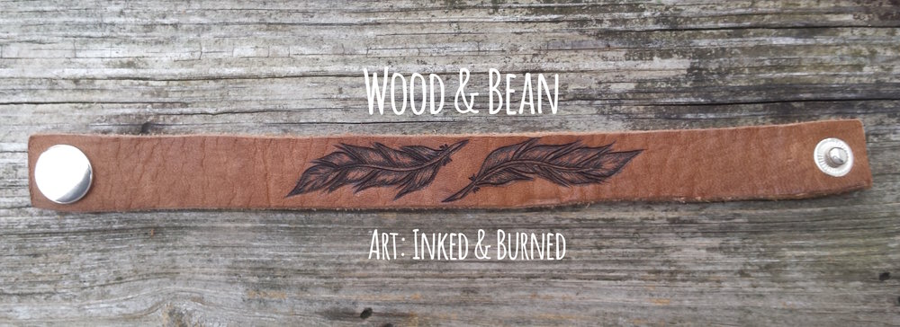 leather feather band logo wood and bean.jpg