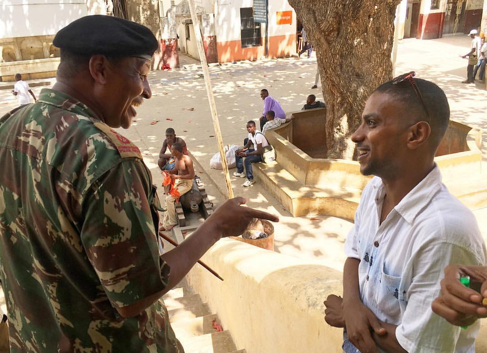 A Kenyan police commander discusses policing practices with a young man in Lamu County – another hotspot in Kenya's war with al-Shabaab. Photo: Margot Kiser