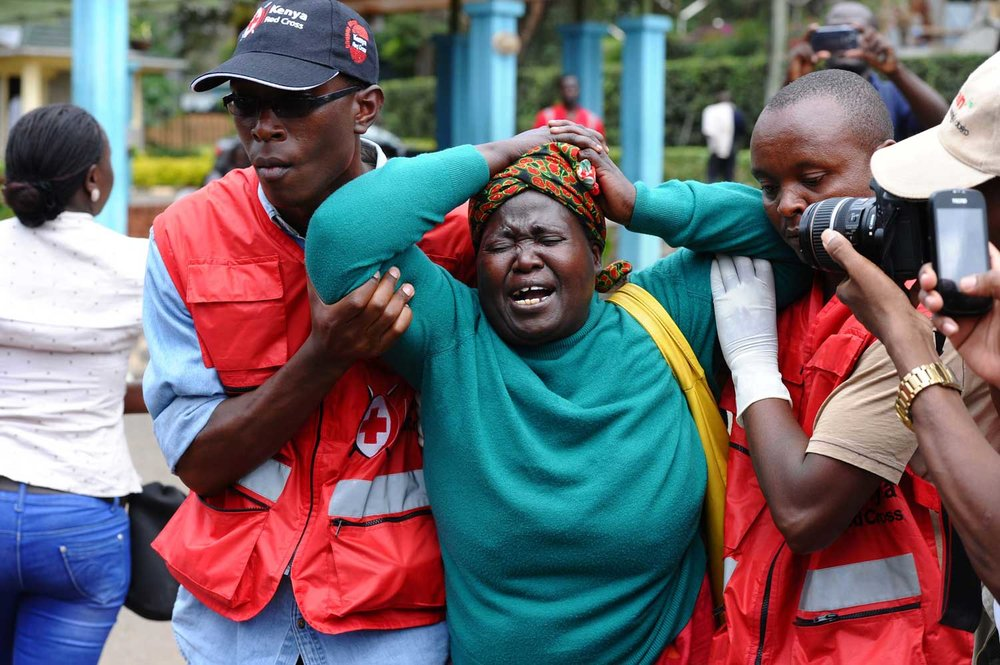 A woman is stricken with grief after the Garissa University College attack. The shockwaves led local communities to come together in rejecting further violence. Photo: Stringer/AP/REX/Shutterstock