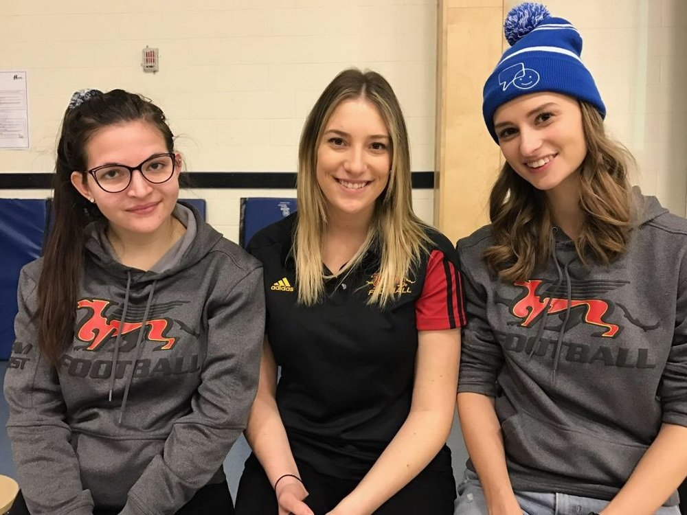 The past three Gryphon Football co-op students. From left to right: Alex Zebeljan, myself (Taylor Floris), and Sarah Shepherd at John Galt Public School for Bell Let's Talk Day.