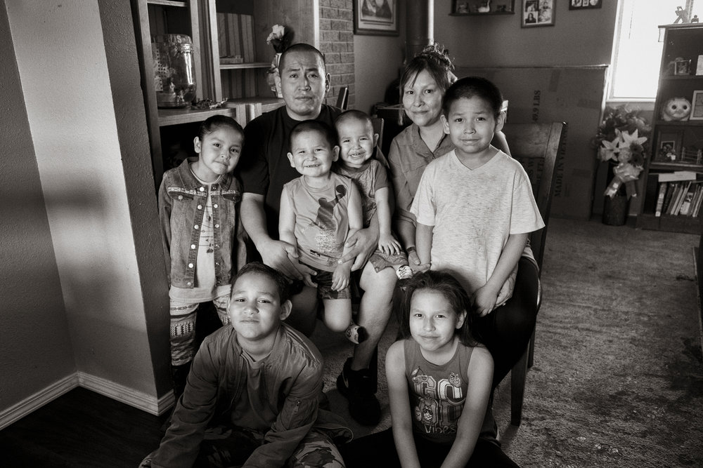 The Lee family at their home on the Navajo Nation, in Window Rock, Arizona: From top left, Brendan Lee and Lisa Lee, Kadence, Bruce, Nicholas and Xavier, Zachary, and Dominique . Don Usner / Searchlight New Mexico.