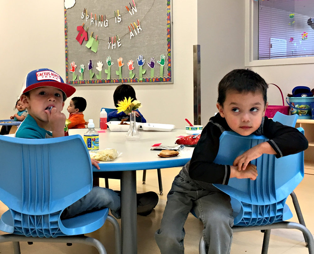 Children at the Bright Beginnings Child Development Center in Jal gather at the family style tables to eat lunch.   Xchelzin Pena // New Mexico In Depth