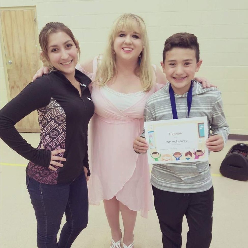 Elizabeth with students Camryn Juarez and Mateo Juarez