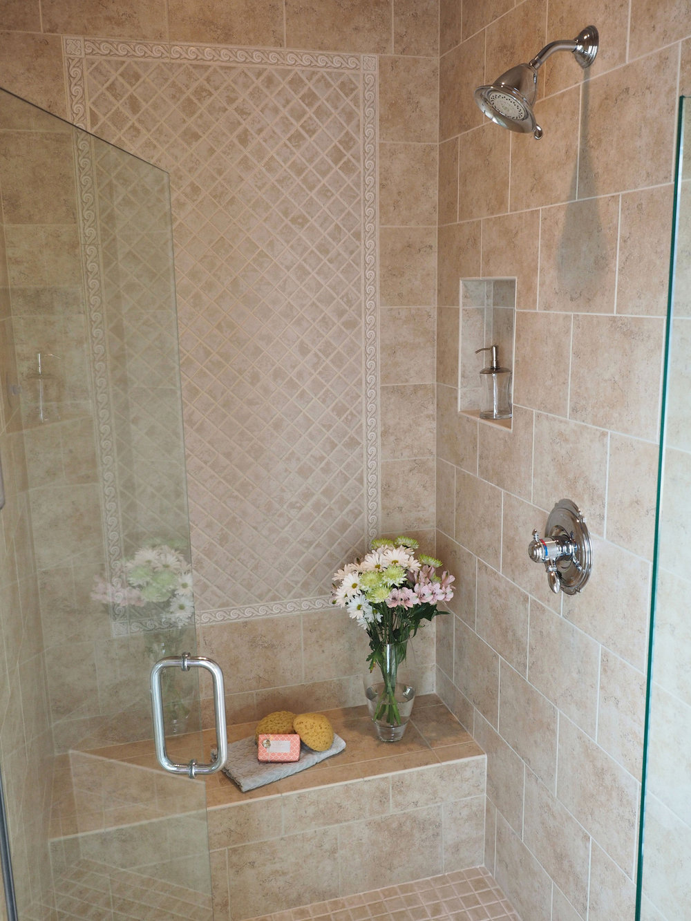 The shower featuring Dal-Tile, Brixton series and the color is sand. Inset design is same tile series but the color is bone.