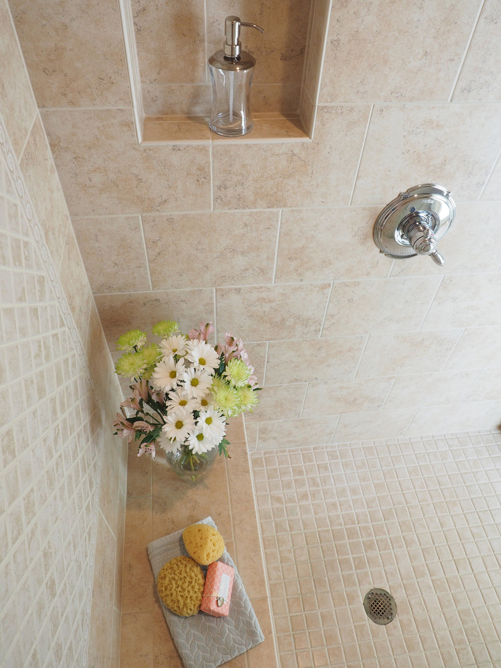Because everyone has flowers in their shower .. right?!  I hope you have enjoyed the before and after of our master bathroom makeover. Not much was done but that change in paint color made all the difference. Thanks for stopping by!