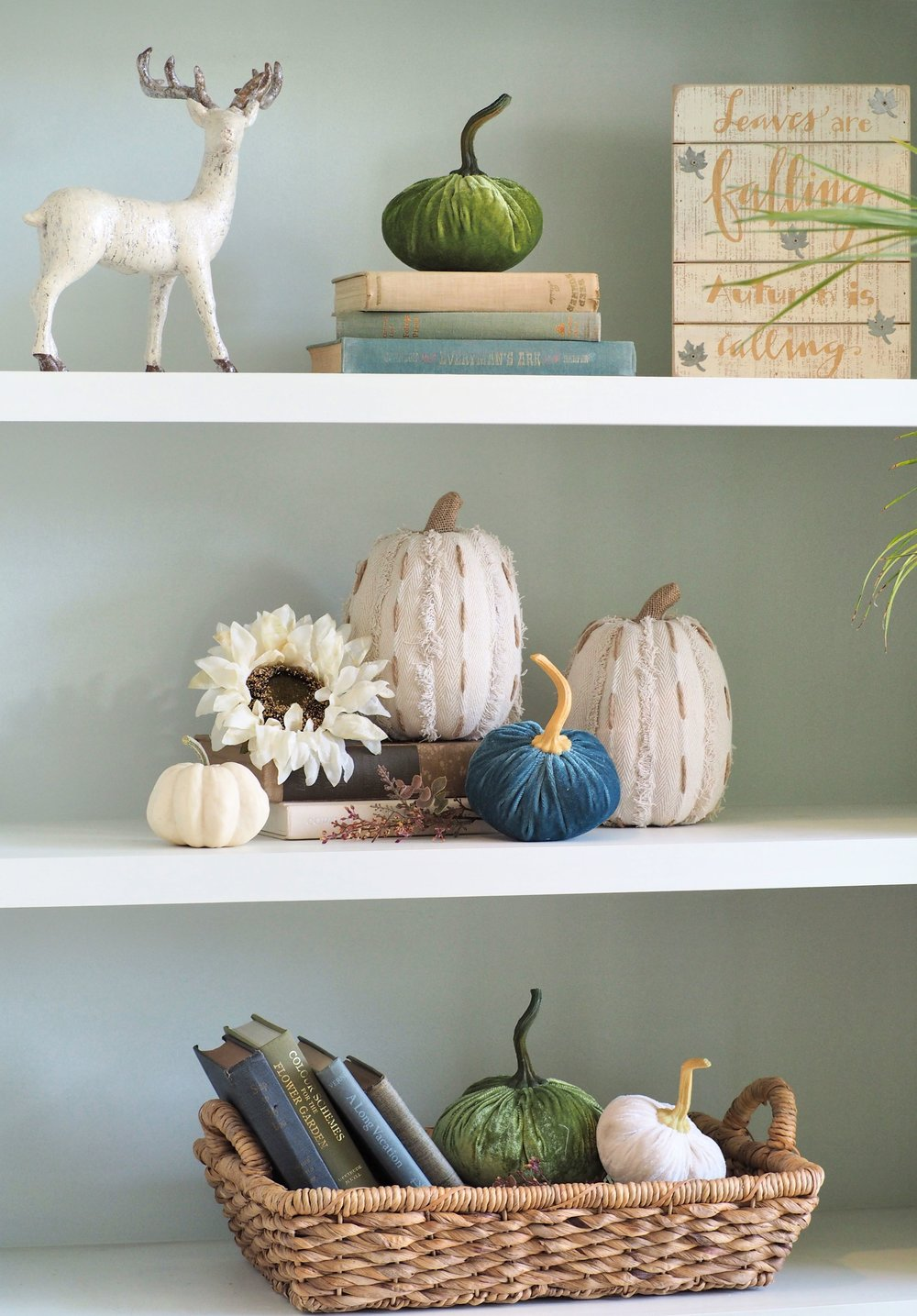 The built-ins were decorated completely neutral in September but have since jumped on the bandwagon with pops of color. The velvet pumpkins are going strong again this year and since I failed to purchase any last year, I finally found a few that were the most perfect colors for my home. I found mine at Marshall's and Home Goods. This wicker basket was purchased at Target last summer 2016. The deer is a favorite of mine and it actually has sparkle on it that is not visible in this photo. He was found at a local boutique here in town. The tall, off-white fabric pumpkins were found at Home Goods and I'm thinking they had an abundance of them because I've been seeing them around Instagram and a couple friends have mentioned having them as well. Leaves are falling, Autumn is calling ... also a Home Goods find! It's embarrassing how much I shop at that store! Are we all guilty of that? I sure hope so! Maybe I should expand my horizons at some point but that store is so darn handy and they always have an incredible variety of items.