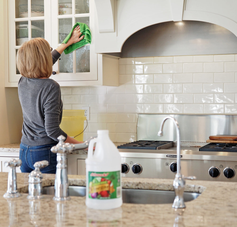 Distilled white vinegar and it's many uses. Here I have mixed up a solution for cleaning the glass front cabinets as well as all the cabinet doors and drawers.