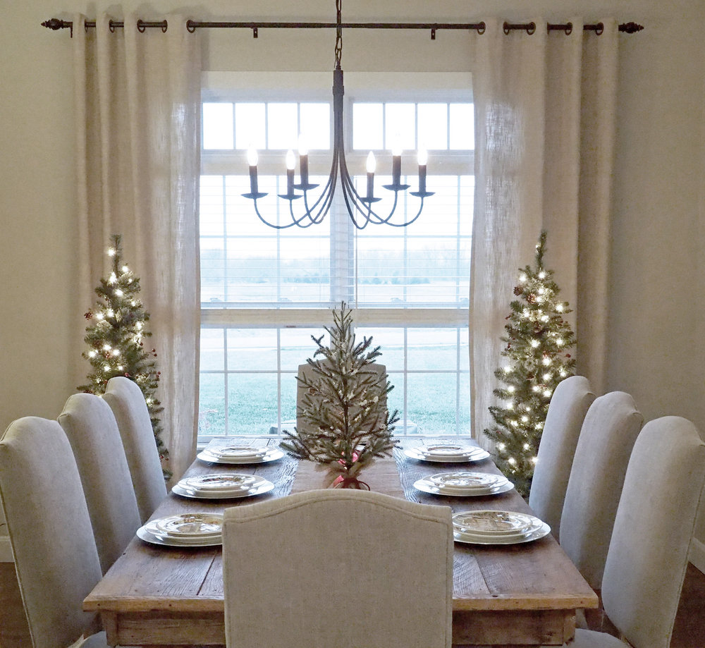 The Pottery Barn     chairs fit comfortably around the table. Curtain panels are from  Pier 1 Imports .