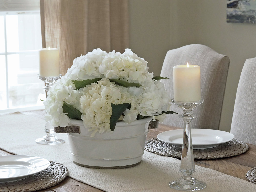 Crystal and rustic go together like peas and carrots in my book! Just love the look anytime I see the two together. The painted clay pot was a fabulous find at Pier 1 Imports a few years ago. Faux  hydrangea flowers  from Pier 1 and Michael's.