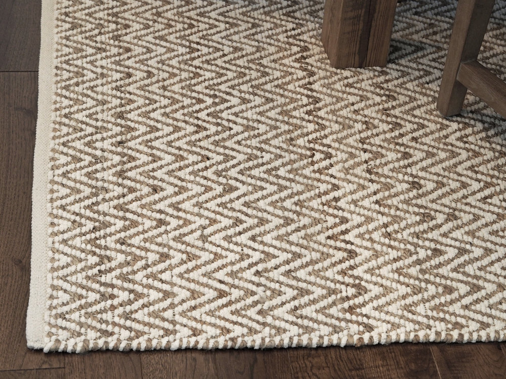 I am so in love with this rug! Jute/Chenille Herringbone Rug in Natural/Ivory by  West Elm .