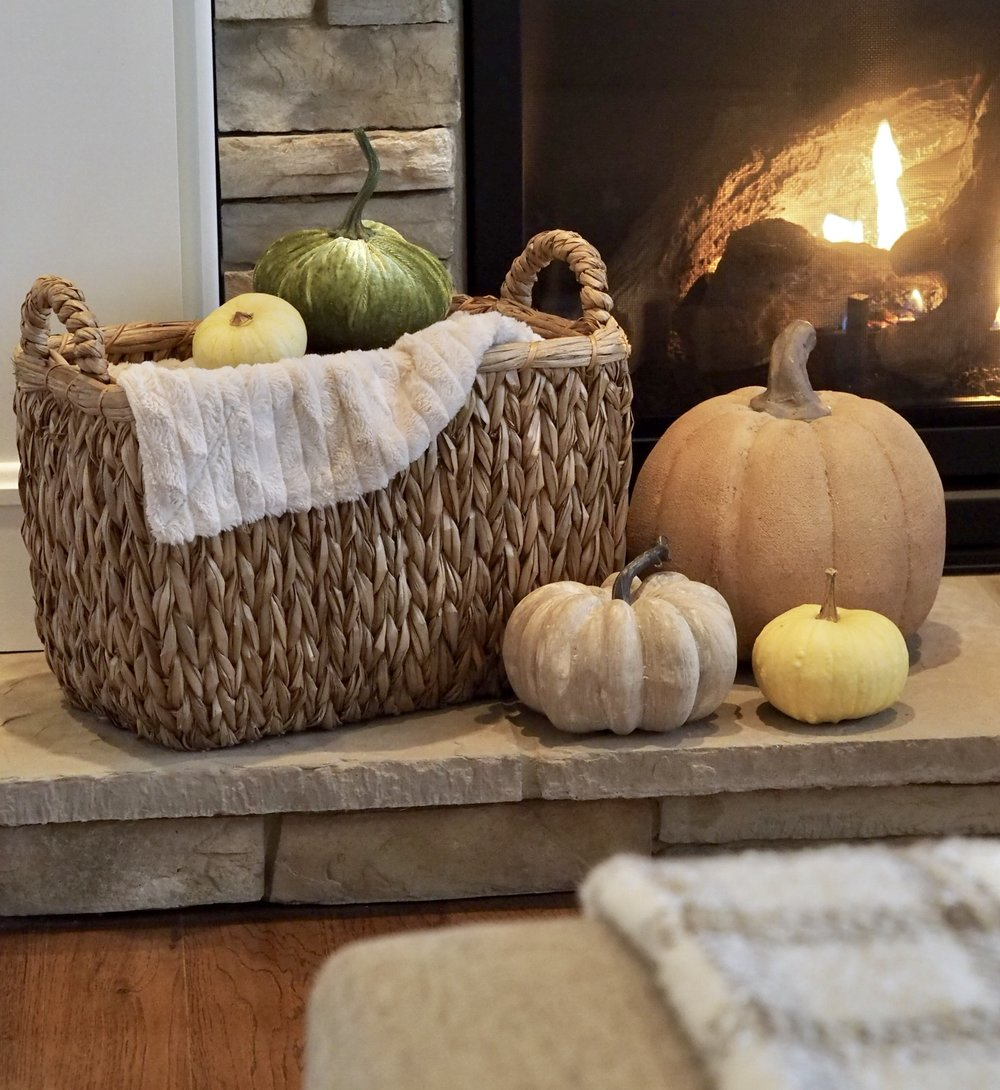 Mixture of faux and real pumpkins. Basket is from Home Goods.