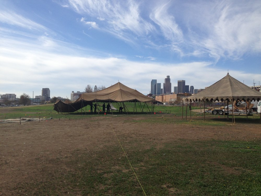 Tents going in.  We chose a location on the North East of downtown LA.  The modern backdrop of the cityscape and our old world circus was a nice contrast with the metro screaming past us every ten minutes.