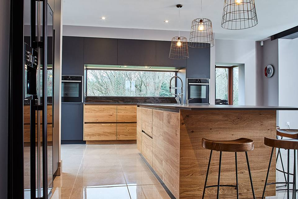 Copper accents with the light fixtures and the dark blue tones of the cabintry really bring the worktop and overall look of this project to life.